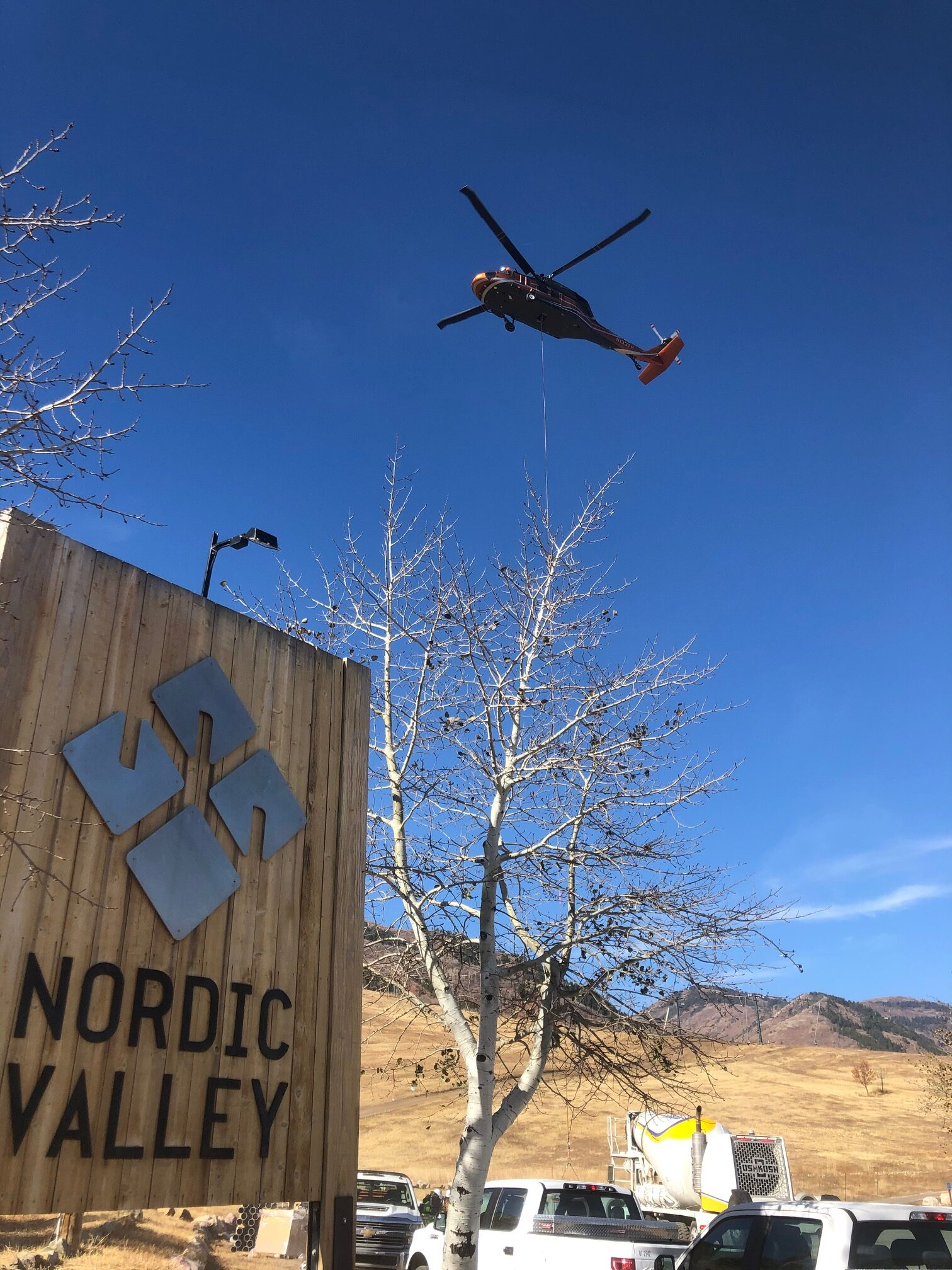 Helicopter hauling parts up the mountain